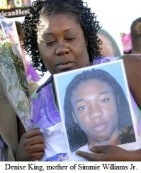 Simmie Williams' Mother, Denise King, Holding Photo of Slain Son
