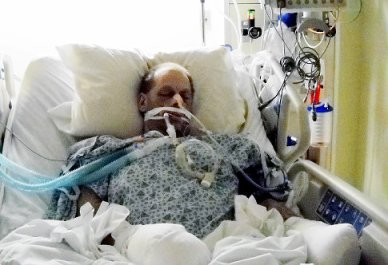 Jack Price speaks from his hospital bed (NY Daily News photo).