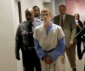 Derek Shrout, 17, alleged hate crime bomb plotter, escorted from Russell County Court on Monday (Ledger-Enquirer image).