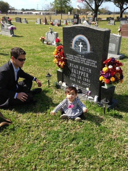 Damien Skipper and his daughter Ryan at the grave site of Ryan Keith Skipper (photo courtesy of the family).