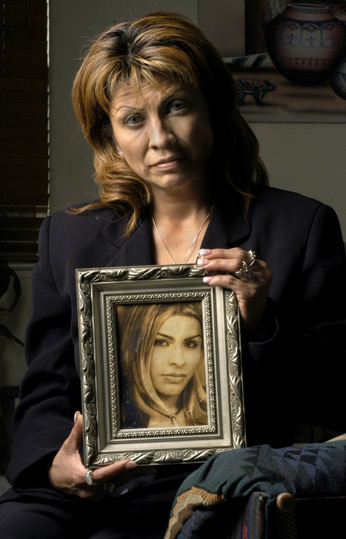 Gwen Araujo's mother, Sylvia Guerrero, cradles her portrait. Thanks to the ABA, the so-called Gay and Trans Panic excuses for violence may one day be a thing of the past.
