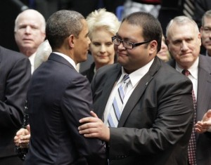 President Obama congratulates gay hero Daniel Hernandez for his role in saving Rep. Gabrielle Giffords' life in 2011 [AP photo].