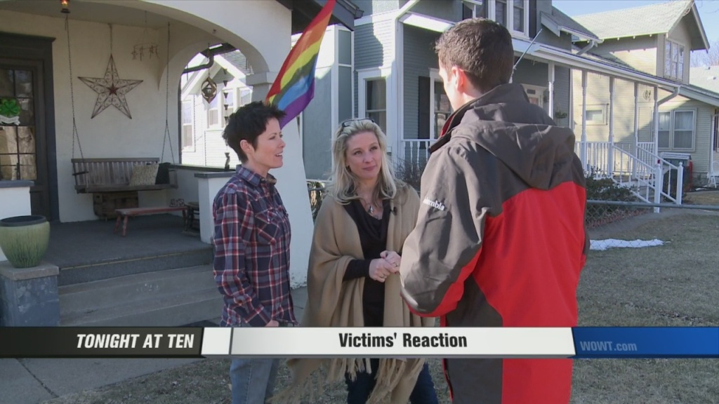 Lesbian spouses Ariann Anderson and Jess Meadows-Anderson speak with WOWT 6 reporter about their brush with hatred and flag burning in their quiet Omaha neighborhood.