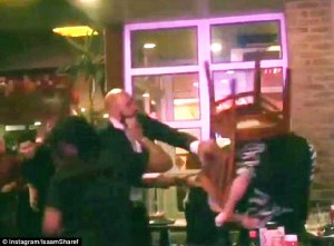 After peppering a gay couple with homophobic slurs, an assailant beats the men with a wooden chair.