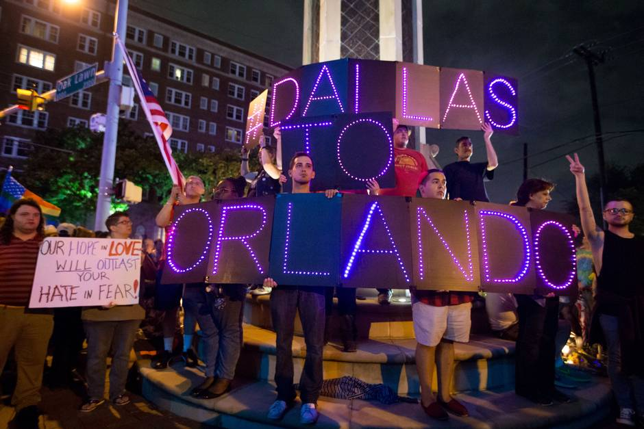Hundreds of LGBT Dallasites and allies rally in solidarity with Orlando despite the rain.